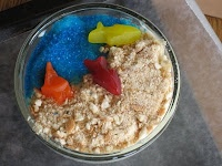 We make a beach pudding with similar idea to this almost every year for our WINGS kids beach party.  It's a great activity becauce the kids can measure ingredients and mix their own pudding, crush their own graham crackers or vanilla wafers, decorate--all in one sitting of about 10 minutes!