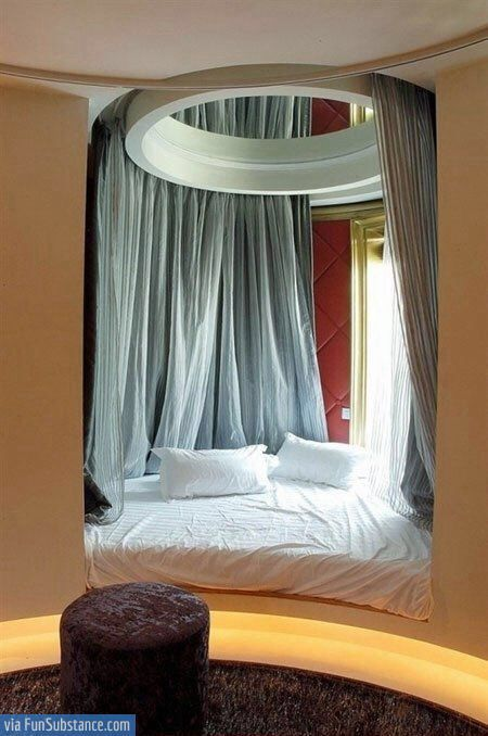 curtains that hang from that circle thingy above the bed! I need this, but will never get it. :( :,(