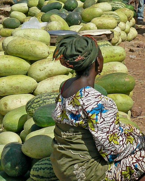 Lady Selling Watermelons in market - San, Mali     (San is an urban commune, town and capital of the Cercle of San in the Ségou Region of Mali.)