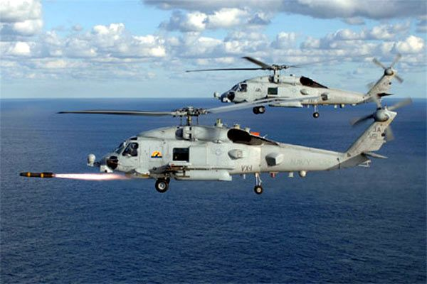 The MH-60R firing a Hellfire missile.
