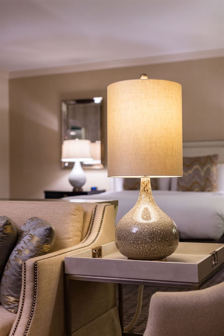 Tying the room together at the Royal Sonesta Harbor Court Baltimore, Baltimore, USA. It was a pleasure to supply a variety of chandeliers, sconces and lamps for the massive renovation of the hotel. #lighting #design #interior #hospitality #hotelroom #lamp #ceramic  #fabric