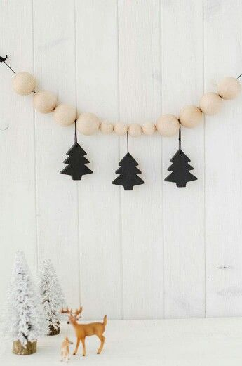 3 black Christmas trees
