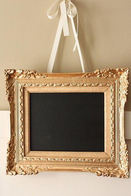 DIY 5 minute chalkboard frame. I really like the gold frame and white ribbon combination