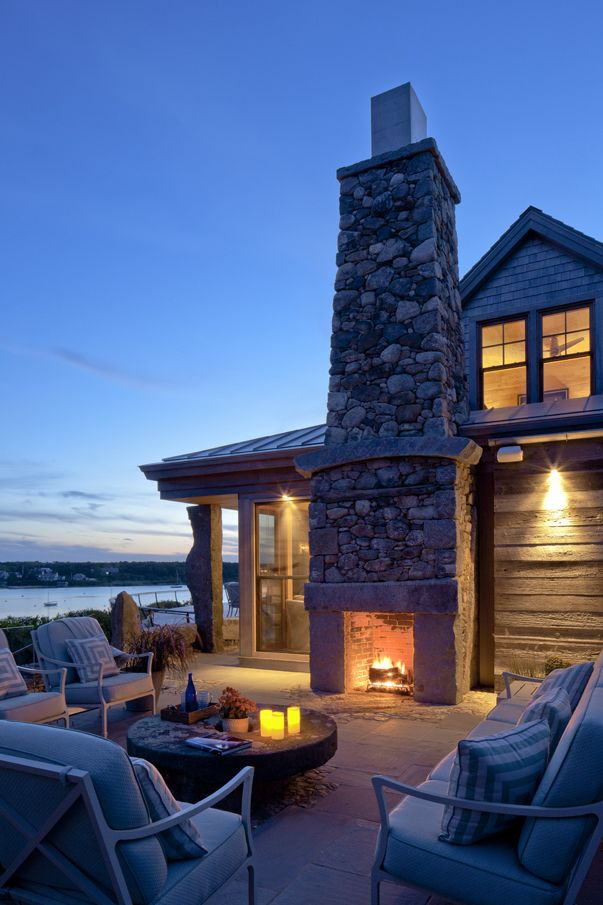 waterfront patio - stack stone fireplace