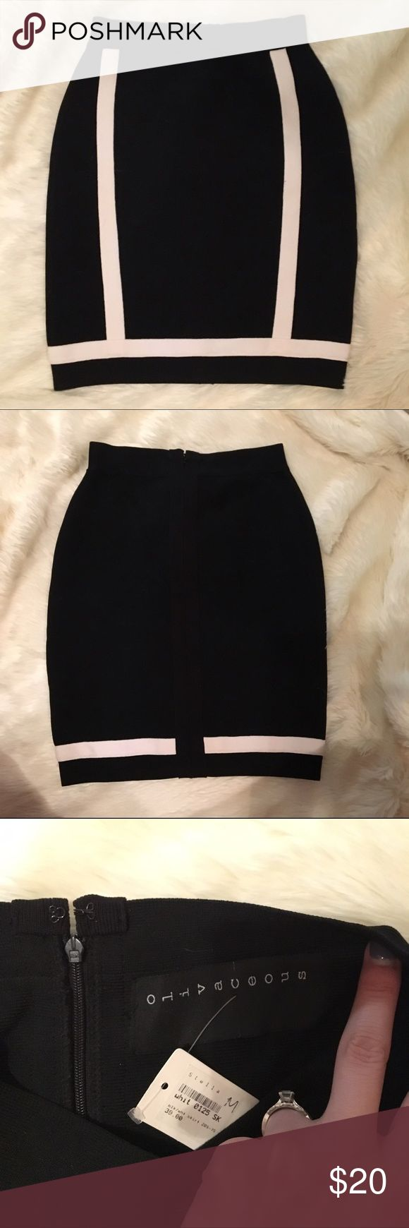 NWT black and ivory bandage skirt M New with tags black bandage skirt M. Very stretchy material. Black with ivory trim. Back zipper. From a local boutique olivaceous Skirts Mini