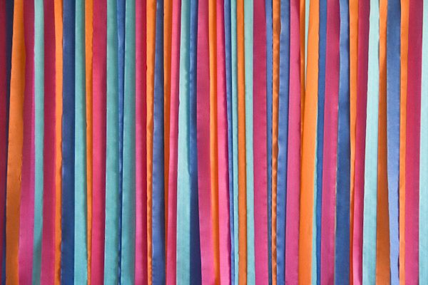 Easy crepe paper streamer background for a photo booth. She says it took 30mins to assemble.