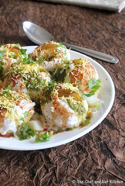 Dahi Sev Puri (Wheat Crackers Filled with Potato-Bean, topped with Chutney, Yogurt, and Crispy Chickpea Noodles). more info: http://www.slashfood.com/2006/06/13/sev-puri-is-an-indian-street-snack/