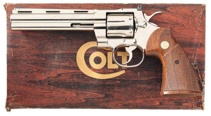 Nickel Plated Colt Python Double Action Revolver with Factory BoxLoading that magazine is a pain! Get your Magazine speedloader today! http://www.amazon.com/shops/raeind