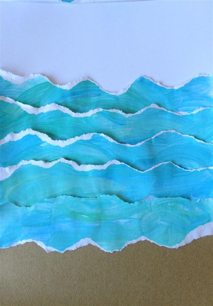 torn painted paper + sand paper. Have kids finger paint blue paper then tear into wave shapes