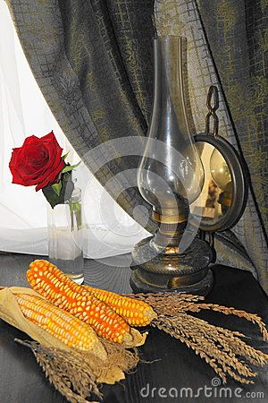 Rustic arrangement with corn and gas lamp