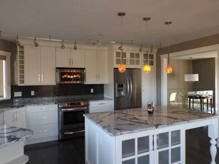 Beautiful new kitchen- shaker style cabinets, pewter maple hardwood, Cambria Seagrove counters.