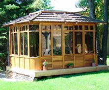 Supreme Gazebo by Alliance Woodcraft. Size is 10x12 with brown roof.