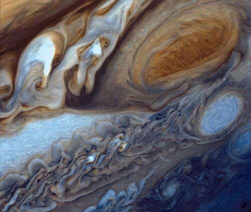 NASA/JPL In January and February 1979, NASA's Voyager 1 spacecraft zoomed toward Jupiter, capturing hundreds of images during its approach, including this close-up of swirling clouds around Jupiter's Great Red Spot. This image was assembled from three black and white negatives and newly released.