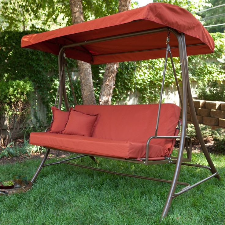 This magnificently cozy swing bed is a wonderful addition to any backyard.