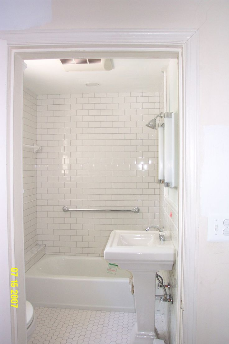 white tiled shower | linking this post to White Wednesday at Faded Charm .