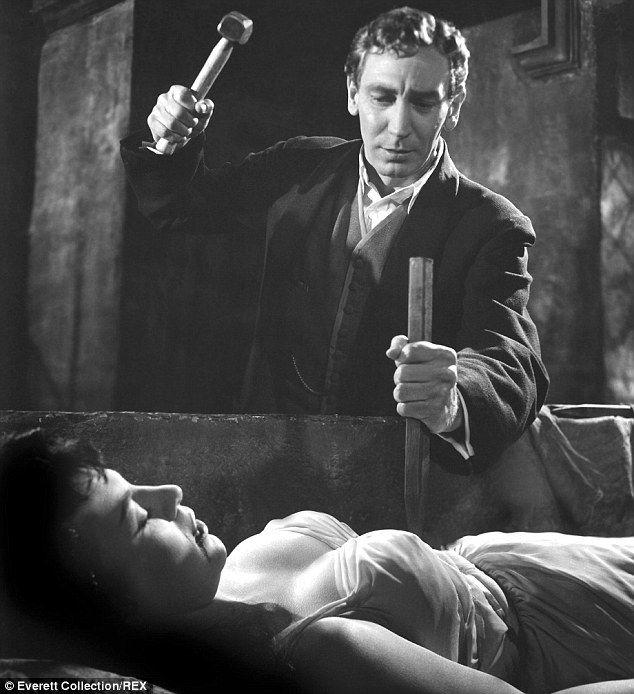 John Van Eyssen, in the film Horror of Dracula, prepares to drive a wooden stake through the heart of vampire.