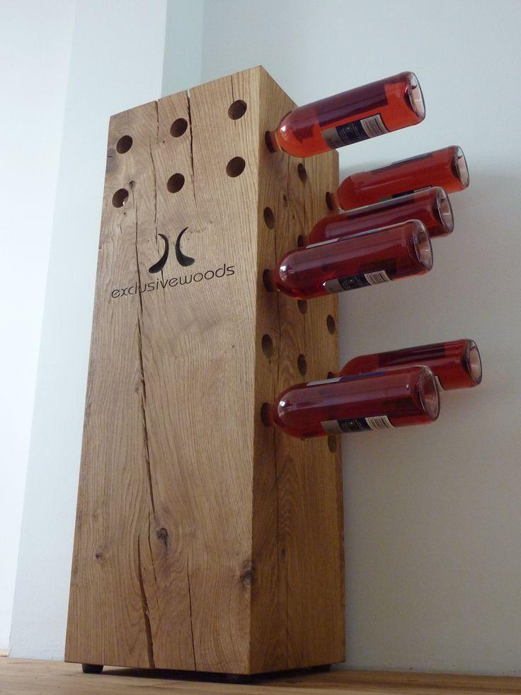 De Exclusive Woods Wijnboom. Een massief houten wijnrek met ruimte tot 60 flessen wijn. In 13 kleuren leverbaar, het aantal gaten kunt u zelf kiezen, met een maximum van 15 per zijde.