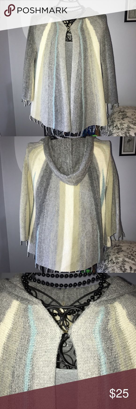 Free People striped wool 3/4 sleeve sweater cape M Super cute Free People striped wool hooded cape with 3/4 sleeves. Has hook closure at base of neckline. Wool/Nylon blend. Perfect condition! Size Medium. Free People Sweaters Shrugs & Ponchos