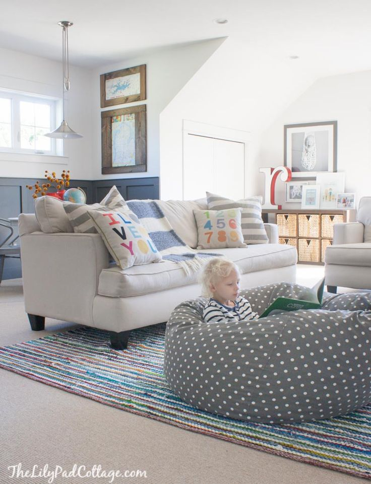Colorful Playroom Decor featuring white walls and lots of colorful accents.