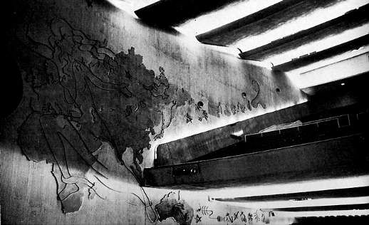 20th Century Johannesburg. The decor could be described as 'modern contemporary' and certainly not atmospheric. The auditorium was decorated by Ernest Ullmann who used a giant relief map of the world on the auditorium walls as a symbolic figure of moving entertainment covering the hemispheres.