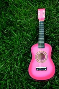 I have decorated my ukulele with pink accents but what I truly crave is a pink concert uke.