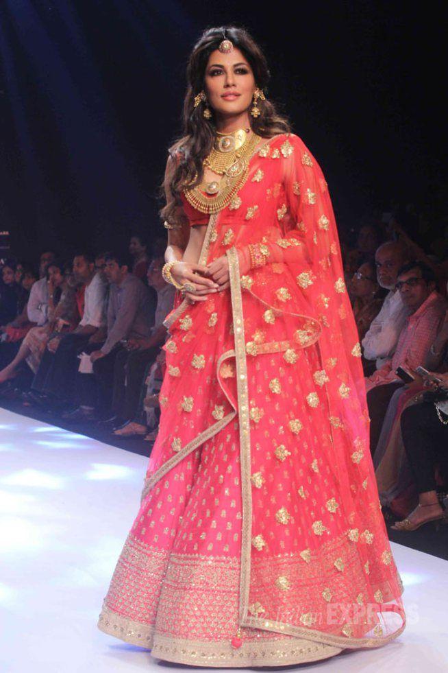 Chitrangda Singh in a red lehenga at the India International Jewellery Week 2015.