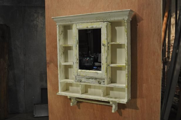 After: Shabby Chic Upgrade A new mirrored front and extra shelving make this repainted medicine cabinet an even more useful amenity.
