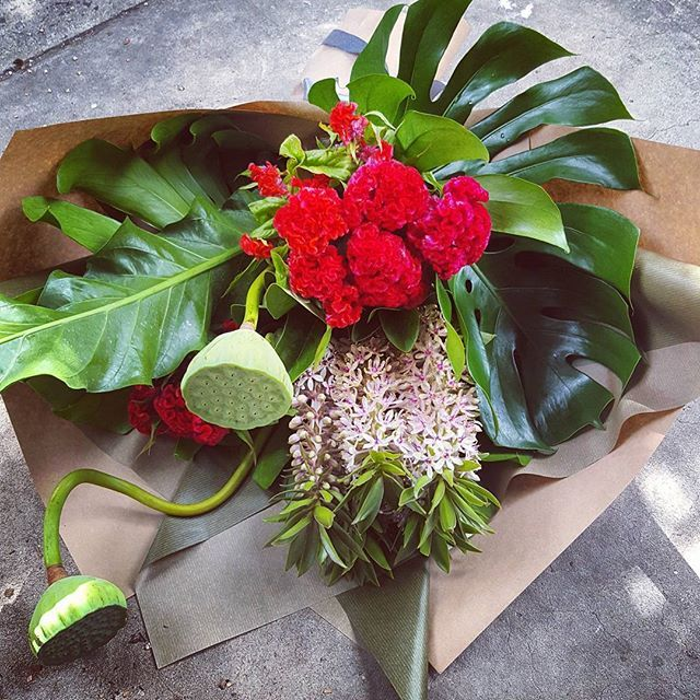 Modern bouquet featuring Pineapple Lily, Celosia and Lotus Pods