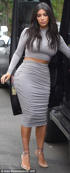 Kim Kardashian recycles go-to crop top and skirt to film with Khloe