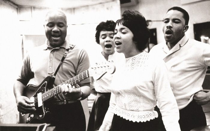 The Staple Singers in the 1960s. [The Staple Singers' special dynamics: Pops, a tenor, and Mavis, a skinny girl with a thundering voice.]