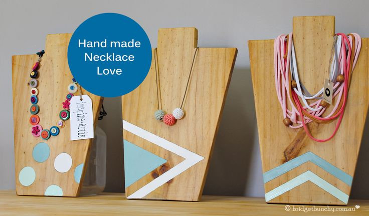 Jewellery display stands made from recycled pine with hand painted geometric details.