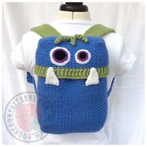 The Knapsack Monsters Crochet Pattern from Hooked On Patterns. Crochet this fun backpack for carrying stuff! www.hookedonpatterns.com