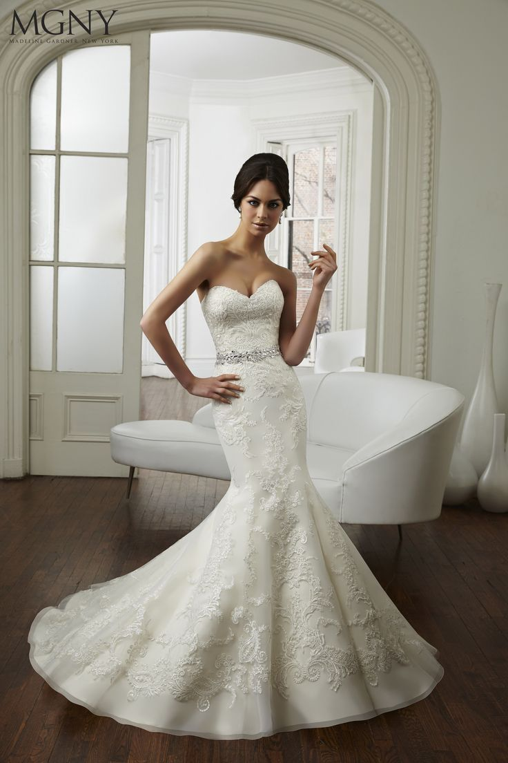 Michelle Keegan Designer Wedding Dress - Get the look. This stunning fishtail lace wedding dress features a dropped back and and an embellished belt to perfectly complement its sweetheart neckline. Created by Madeline Gardner New York MGNY, the Charlotte gown is a stunning dress.