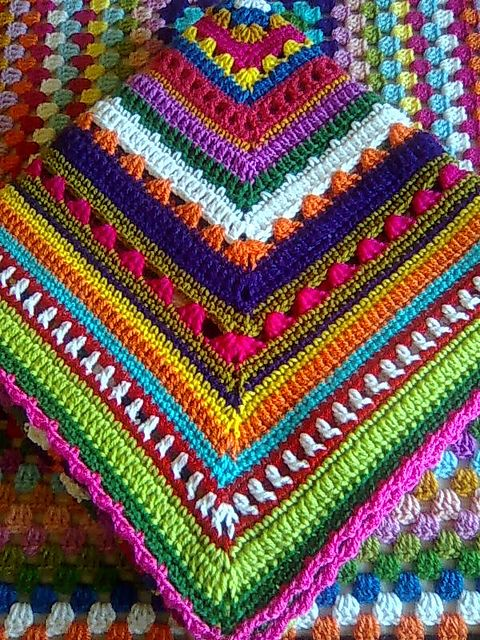 Crochet blanket with each round in a different color and pattern