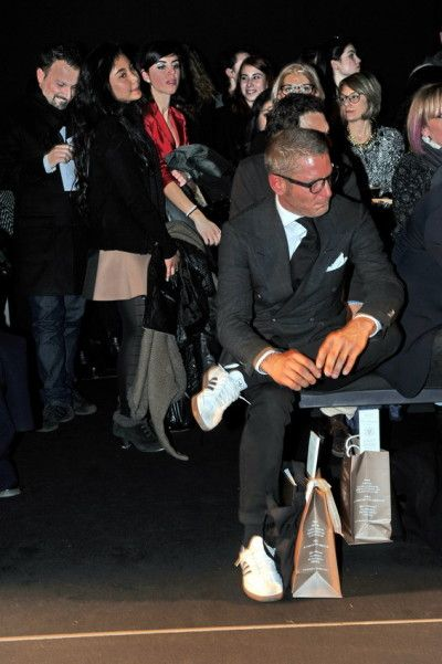 Lapo Elkann black suit; white shirt; black tie; white sneakers; men's style; how to dress for a runway show