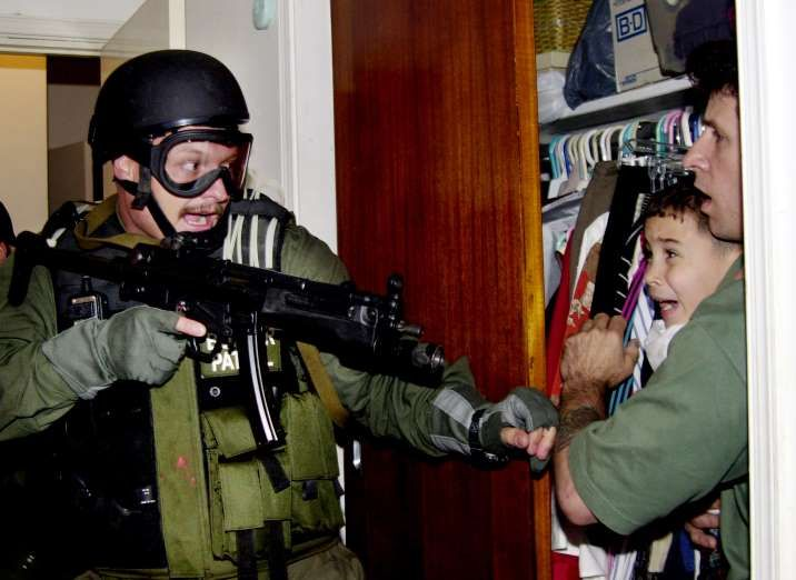 Elian Gonzalez, held by Donato Dalrymple, is taken by U.S. federal agen... - Alan Diaz/Reuters