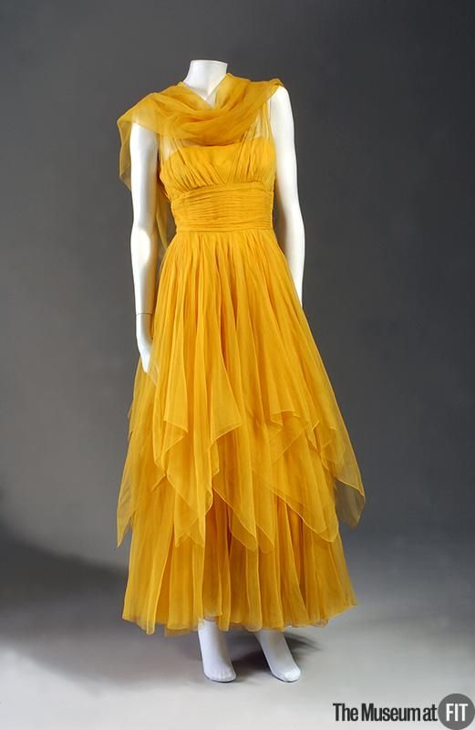 """Evening Dress, Traina-Norell (1941 - 1960) for Norell (1900-1972) sold at Bonwit Teller (American, 1897 - 1990): ca. 1947, American, silk chiffon gauze. """"The full skirt of Norell's yellow 'daffodil' evening dress is layered with handkerchief-point overskirts to create a weightless, flower petal effect...In the absence of surface ornamentation...ingenious styling strikes the perfect balance..."""""""