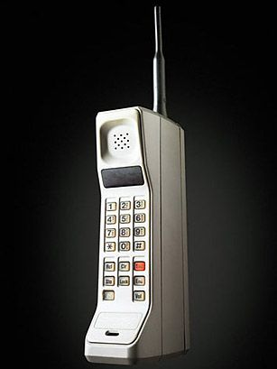 My old phone. DynaTAC 8000x was sold as the first commercial handheld cellular phone in 1983. It weighed 1.75 lb., stood 13 in. high, stored 30 numbers, took 10 hours to recharge and cost $3,995.