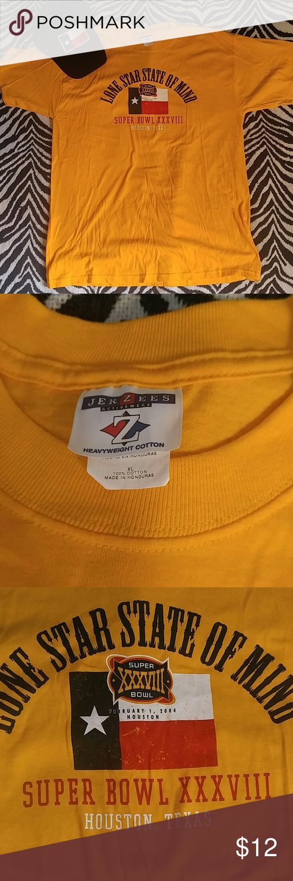 Vintage Super Bowl XXXVIII t shirt L Vintage item from 2004 to celebrate the Super Bowl in Houston. Great condition with stint blue spot on back of sleeve (picture 4) that is not noticeable when worn. Colors really pop! Vintage  Shirts Tees - Short Sleeve