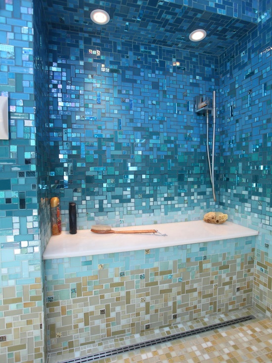 A caribbean getaway in your own home! This tropical bathroom is completely covered in a custom designed glass tile mosaic that goes from the deep blue of the ocean to the sandy colored floor. Surround yourself in relaxation and beauty!
