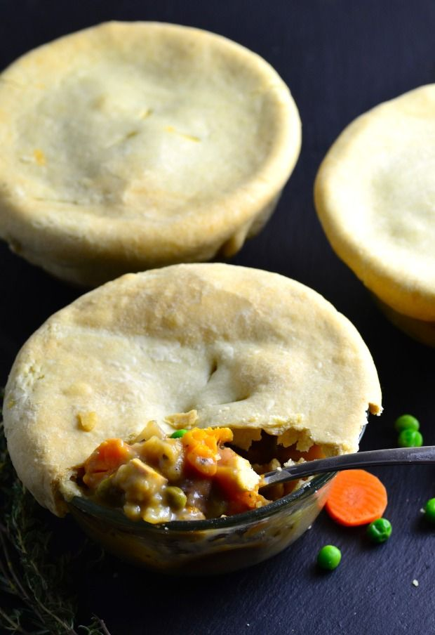 Quick & Easy to make Vegan pot pies with rainbow carrots and white wine topped with a comforting olive oil crust. Just perfect!