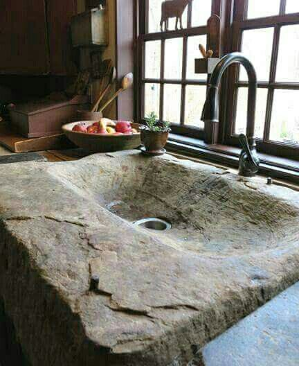 This primitive kitchen must have a dishwasher, because although I really like the look of this sink, it is not very practical.