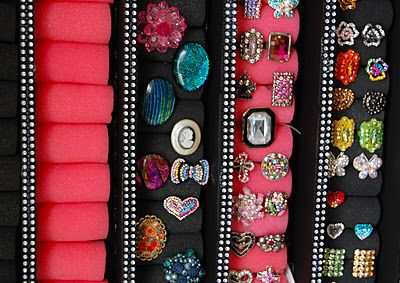 Ring holder using foam dollar store curlers and a box lid also this link is the how to tutorial http://sellzcutethings.blogspot.com/2011/10/super-easy-diy-nail-polish-wall-rack.html