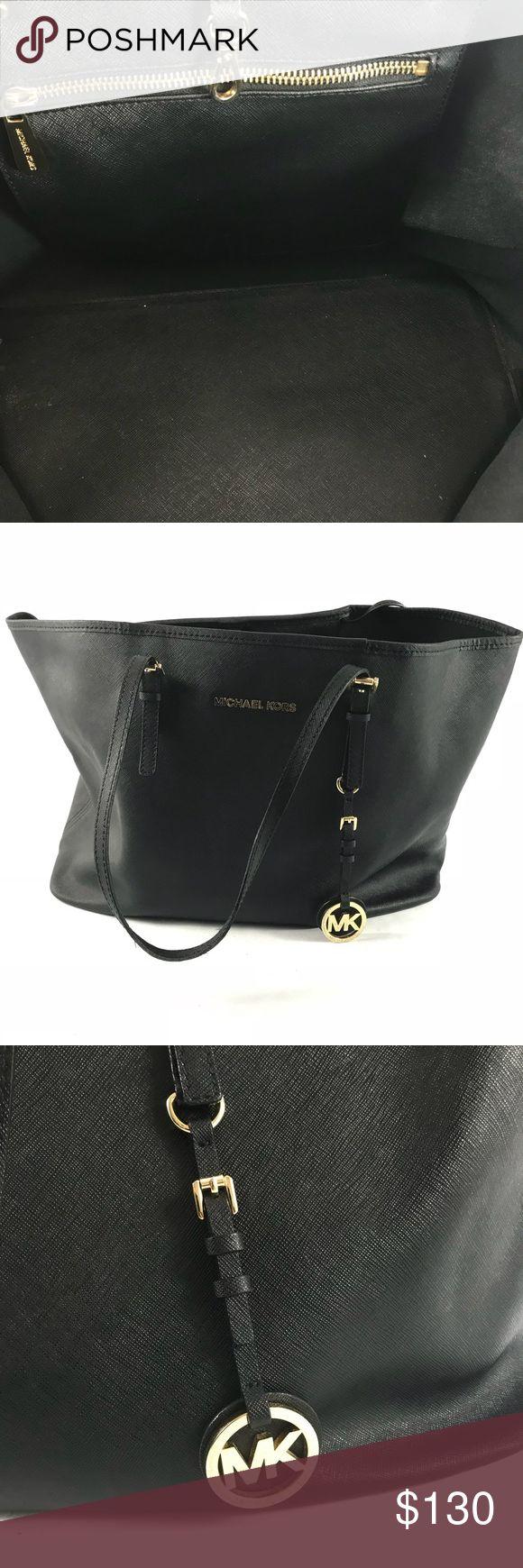 Michael Kors large Black tote bag Pre-owned Michael Kors large Black tote bag.  See pictures for condition.  Great condition. Classic handbag. Michael Kors Bags Totes
