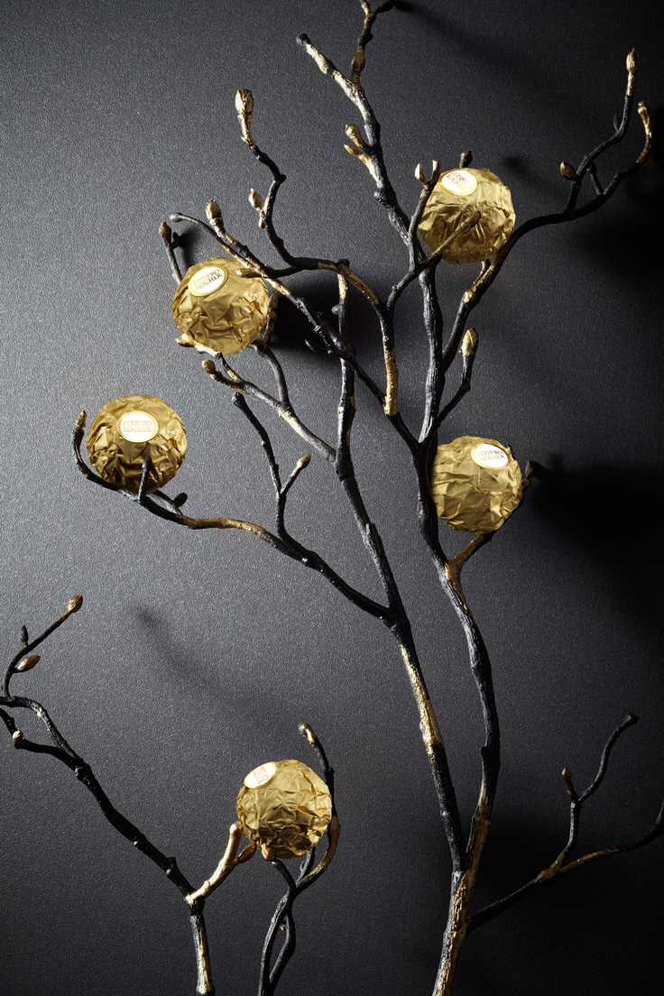 An artistic, #gold painted branch with #FerreroRocher