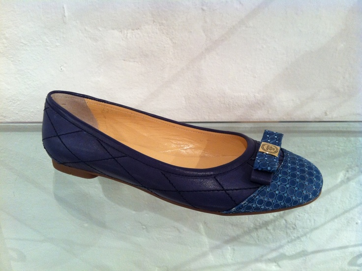 Blue pumps by Francesca.