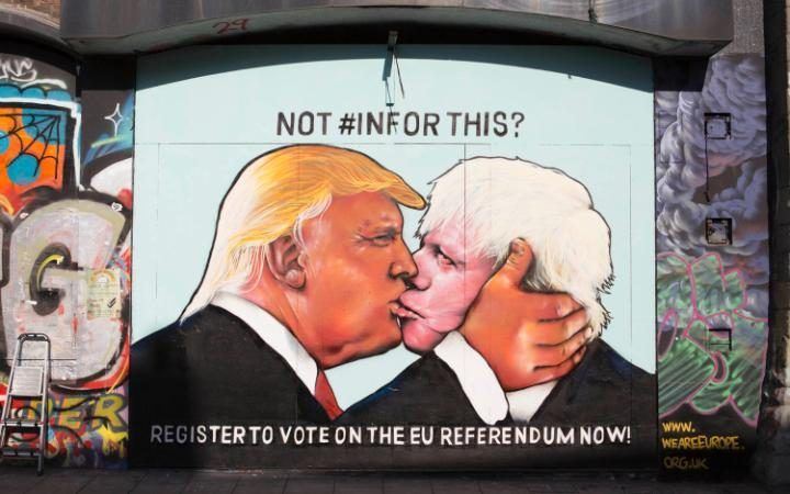 Graffiti in Stokes Croft, Bristol, depicting Donald Trump kissing Boris Johnson, reminiscent of the 1979 photograph taken by Regis Bossu of 'The socialist fraternal kiss' between East German politicians, Erich Honecker and Leonid Brezhnev. The street art piece reminds people to 'Register to Vote on the EU referendum'.