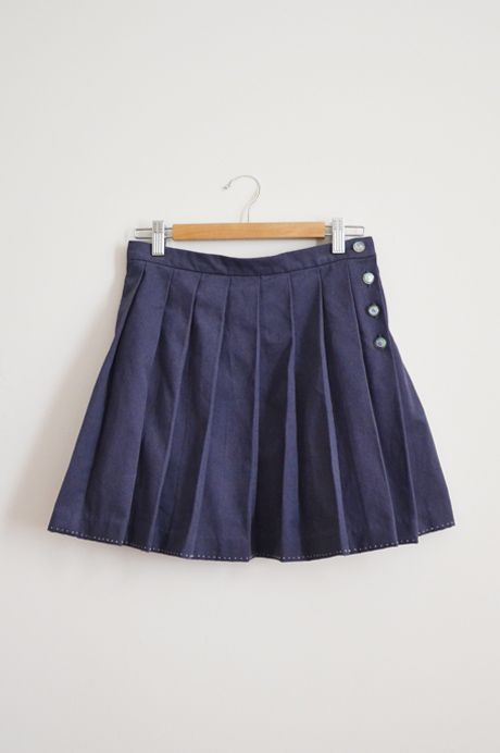 pleated skirt with resin buttons by Minus Sun