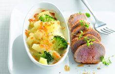 Gegratineerde aardappeltjes met varkenshaasje, knolselder en schorseneren