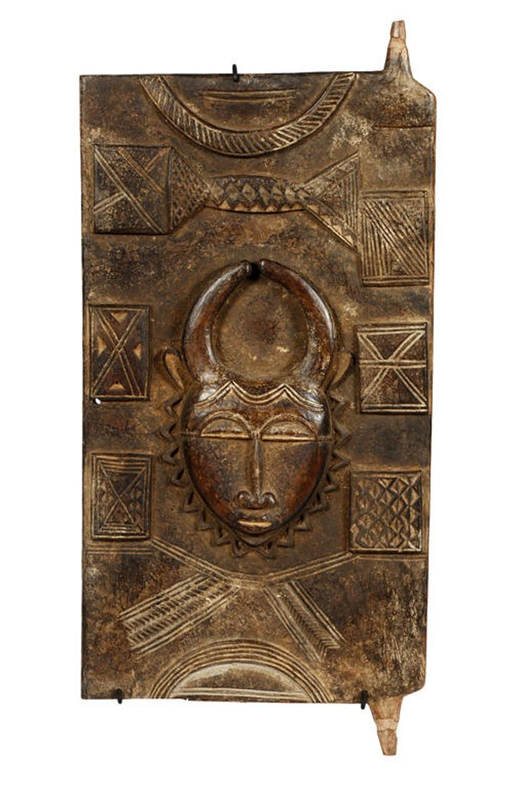 Africa | Granary door from the Baule people of the Ivory Coast | Wood; encrusted patina with traces of Kaolin